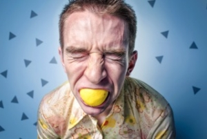 anxiety therapy stressed man bites lemon